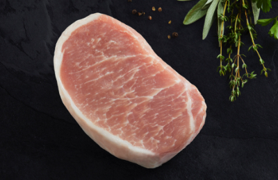 A single pork chop on a black background